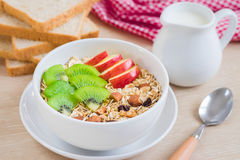 Muesli with fresh fruit, milk and whole wheat bread Stock Photo