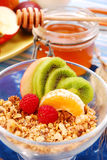 Muesli with fresh fruits as diet breakfast. Bowl of muesli with fresh fruits as diet breakfast royalty free stock photos