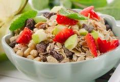 Muesli and fresh fruits for breakfast Stock Image