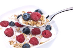 Muesli with fresh fruits on a spoon Stock Photos