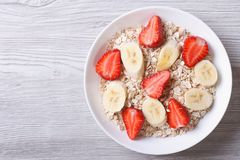 Muesli with fresh strawberries and banana horizontal top view Royalty Free Stock Image