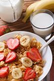 Muesli with fresh strawberries and banana vertical top view Stock Images