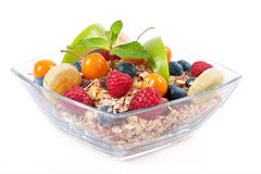 Muesli with fruits in a bowl Royalty Free Stock Images