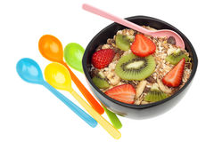 Muesli and fruits in bowl isolated Stock Images