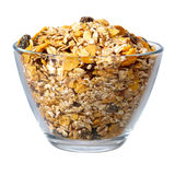 Muesli in glass bowl over white Royalty Free Stock Photos