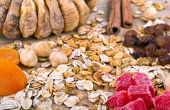 Muesli Granola oat flakes on wooden board Stock Photos