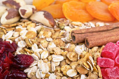 Muesli Granola oat flakes on wooden board Royalty Free Stock Image