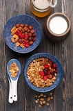 Muesli granola oatmeal with honey, nuts and dried fruits. Healthy breakfast. Top view. Stock Image
