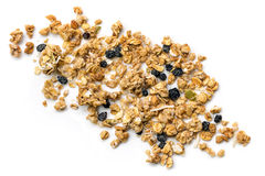 Muesli or Granola Scattered on White Top view. Crunchy granola or muesli scattered, isolated on white, top view Stock Image