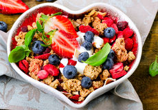 Muesli in heart shaped bowl Stock Photos