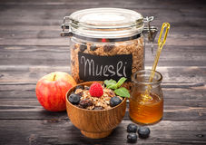 Muesli with honey, raspberries, blueberries and fruit. Healthy Breakfast Stock Photos