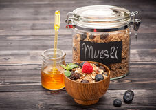 Muesli with honey, raspberries and blueberries. Healthy Breakfast Stock Image