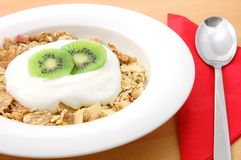 Muesli with kiwi. Healthy breakfast, cereal with fresh fruits on the table Stock Photo