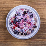 Muesli made from blackberry, oat flakes with yogurt, raspberry jam and honey, close up Stock Photo