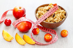 Muesli meter tape on wooden background royalty free stock photos
