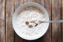 Muesli with milk. Breakfast background, a bowl Muesli with milk Royalty Free Stock Images