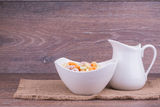 Muesli with milk Stock Photos