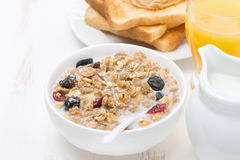 Muesli with milk and dried fruit, toast with peanut butter Stock Photos