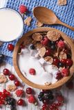 Muesli with milk and fresh berries close up vertical top view Stock Images