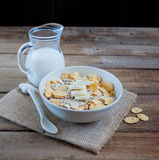 Muesli and milk jug Stock Photos
