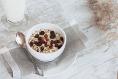Muesli, milk and raisins. Horizontal composition of healthy breakfast with muesli, milk and raisins royalty free stock photos