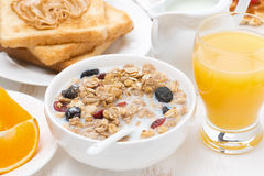 Muesli with milk, toast with peanut butter and juice Stock Images