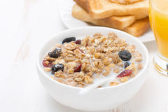 Muesli with milk, toasts with peanut butter Stock Image
