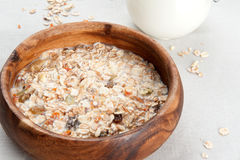 Muesli with milk in wooden bowl Royalty Free Stock Photos
