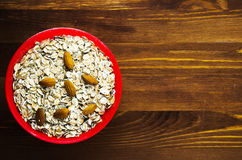 Muesli with nuts almonds. muesli on a wooden table. muesli top v Royalty Free Stock Images