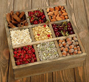 Muesli, nuts and berries in a wooden box Stock Images