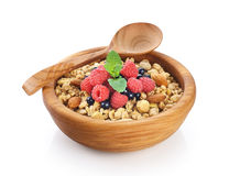 Muesli with nuts and fresh berries in a wooden bowl Royalty Free Stock Images