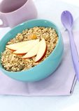 Muesli of oats and apple in blue bowl Royalty Free Stock Photos