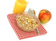 Muesli of oats, glass of juice and apple isolated Royalty Free Stock Images