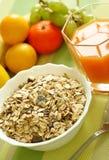 Muesli of oats with raisin, fresh fruit and juice Royalty Free Stock Photography