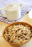 Muesli of oats with raisin in wooden bowl Royalty Free Stock Image