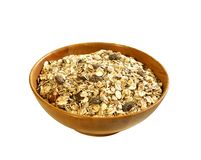 Muesli of oats with raisin in wooden bowl isolated Stock Photography