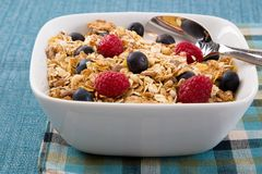 Muesli with Raspberries and Blueberries Stock Images