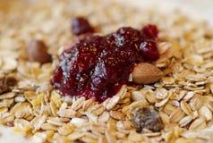 Muesli with raspberry jam. Delicious muesli with raspberry jam for breakfast Royalty Free Stock Photo