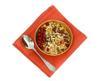 Muesli and red currant in wooden bowl isolated on Royalty Free Stock Photography