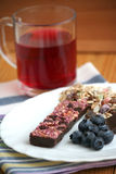 Muesli snack bar, blueberries and berry tea Royalty Free Stock Photography