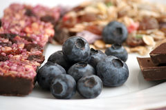 Muesli snack bar, blueberries and berry tea Stock Images