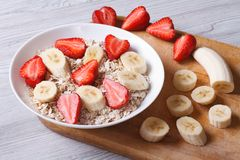 Muesli with strawberries and banana with ingredients horizontal Stock Photography