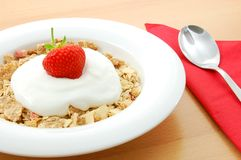 Muesli with strawberry. Healthy breakfast, cereal with fresh fruits on the table Royalty Free Stock Photo