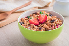 Muesli with strawberry in bowl for healthy breakfast Royalty Free Stock Images