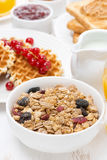 Muesli waffles with berries, jams, milk for breakfast Stock Photography