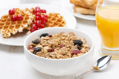 Muesli, waffles with berries and orange juice Royalty Free Stock Photography