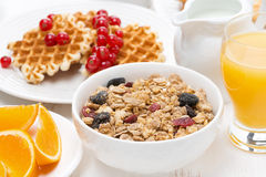 Muesli, waffles with fresh berries and orange juice Royalty Free Stock Images