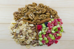 Muesli, walnuts and dried fruit on arranged a table Stock Image