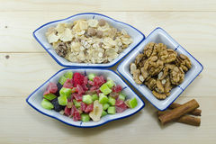 Muesli, walnuts and dried fruit on a table Stock Image