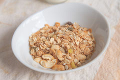 Muesli in white bowl; natural breakfast and snack food closeup. Stock Photos